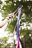 Low angle view of girl playing with ribbons outdoors