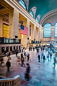 Blurred view of people in train station, New York, New York, United States