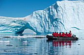 Zodiac raft excursion through ice floes and to iceberg for passengers of expedition cruise ship MS Hanseatic Hapag-Lloyd Cruises, Weddell Sea, Antarctic Peninsula, Antarctica