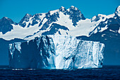 Majestic iceberg and snow-covered mountains, near Gold Harbour, South Georgia Island, Antarctica