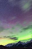 Northern Lights above the Chugach Mountains South of Girdwood, Southcentral Alaska, USA.