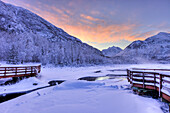 Colorful sunrise over a stream and the salmon viewing deck at the Eagle River Nature Center in Chugach State Park, Southcentral Alaska, Winter, HDR
