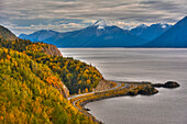 Traffic on the Seward Highway along Turnagain Arm section of the Cook Inlet on a Fall day in South Central Alaska, HDR