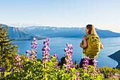 Female hiker on the Bird Ridge trail overlooking Turnagain Arm and the Kenai Mountains, Southcentral Alaska