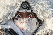 Portrait of Kristi Berington bundled up and frosty in -40 degree temperatures at the Huslia checkpoint during Iditarod 2015