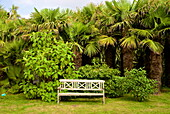 Wooden garden seat, Botanical gardens of Chateau de Vauville, Cotentin, Normandy, France, Europe