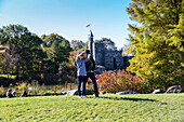 Tourists posing in front of Belvedere Castle, Central Park, Manhattan, New York City, USA, America