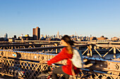 Cyclist on the Brooklyn Bridge, view of the Empire State Building, Manhattan, New York City, USA, America