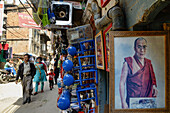 Shopping street in an old part of Thamel with a picture of the Dalai Lama, Kathmandu, Nepal, Himalaya, Asien