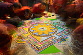 Buddhist monchs preparing a sand mandala with coloured wheat flour. The ceremony lasts for several days. Only very few visitors are granted entrance to this very seldom ceremony. Even less are allowed to take photographs. Lo Manthang (3840 m), former capi