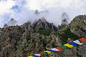 Prayer flags at the Buddhist gompa Yughat at the Nar Phu Trek between Meta and Nar, Nepal, Himalaya, Asia