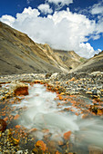 Due to its high iron content, the stream Rijung Prama leaves red traces on its way into Yak Khola, Mustang, Nepal, Himalaya, Asia
