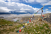 Prayer flags in front of Tangge, tibetian village with a buddhist Gompa in the Kali Gandaki valley, the deepest valley in the world, Mustang, Nepal, Himalaya, Asia