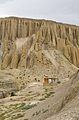 Buddhist chorten in the surreal landscape typical for Mustang in the high desert around the Kali Gandaki valley, the deepest valley in the world, Mustang, Nepal, Himalaya, Asia