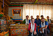 King's audience with the King's son in the middle, Hikers, trekkers in the audience room of the King's Palace in Lo Manthang (3840 m), former capital of the Kingdom of Mustang and residence of King Raja Jigme Dorje Palbar Bista in the Kali Gandaki valley,