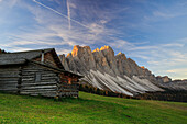 The early morning light illuminates Malga Zannes and the Odle in background, Funes Valley, South Tyrol, Dolomites, Italy, Europe