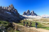 Hikers venturing to discover the Three Peaks of Lavaredo, Sesto, Dolomites, Trentino-Alto Adige, Italy, Europe