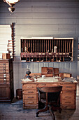Antique desk and mail slots.