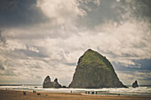 Dramatic sky over Haystack Rock, Cannon Beach, Oregon.