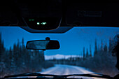 Compass and temperature indication - 38 degrees Celsius in a car above the windshield, Dempster highway, Yukon, Yukon territory, Canada