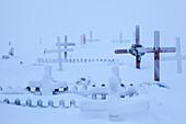 snow-covered cemetery in Tuktoyaktuk, Inuvik region, Northwest Territories, Canada