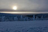 snow covered landscape with morning fog and rising sun at Dalton Highway, Yukon-Koyukuk Census Area, Alaska, USA