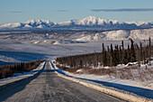 Dalton Highway in wintertime with Brooks Range, Yukon-Koyukuk Census Area, Alaska, USA