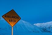 'Roadsign ''Avalnche Area'' at Dalton Highway, North Slope Borough, Alaska, USA'
