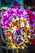 Lei necklace of flowers for sale at Rarotonga Saturday Market Punanga Nui Market, Avarua Town, Cook Islands, South Pacific, Pacific