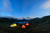 The soft lights of the tents light up dusk, Minor Valley, High Valtellina, Livigno, Lombardy, Italy, Europe