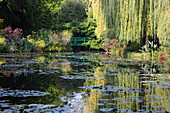 Claude Monet's water garden with the Japanese bridge which he included in many of his paintings, Giverny, Normandy, France, Europe
