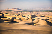 Sand dunes in the desert at Huacachina, Ica Region, Peru, South America