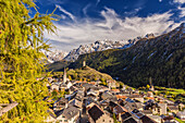 View of Ardez village surrounded by woods and snowy peaks Lower Engadine, Canton of Graubunden, Switzerland, Europe