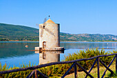 The Spanish windmill on the lagoon of Orbetello, Orbetello, Grosseto province, Maremma, Tuscany, Italy, Europe