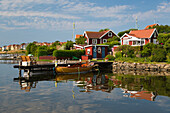 Swedish red summer houses in Brandaholm, Dragso Island, Karlskrona, Blekinge, South Sweden, Sweden, Scandinavia, Europe