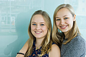 smiling young women, sisters, Germany