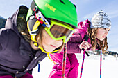 girl and boy skiing on the slope, Pfronten, Allgaeu, Bavaria, Germany
