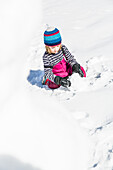 boy building a snowman in winter, Pfronten, Allgaeu, Bavaria, Germany