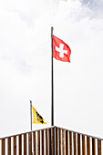 Swiss flag, Flag of Switzerland blowing in the wind, Finsteraarhornhut, Fiescher Glacier, Berner Oberland, Switzerland