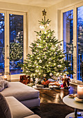christmas tree and presents in a modern apartment in Hamburg, north Germany, Germany