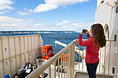Baltic sea, ferry, transfer from Germany to Denmark, girl taking photos with her mobile phone, chalk cliffs, Ruegen island, Mecklenburg-West Pomerania, Germany, Europe