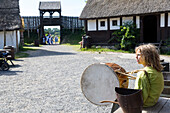 boy playing a drum, tabour, Middle Age Center, Middle Ages Village, Baltic sea, Bornholm, near Gudhjem, Denmark, Europe