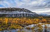 The limestone cliffs of Sapper Hill during autumn along the Dempster Highway, Yukon, Canada