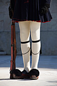 Greek guardsman with rifle from waist down, Athens, Attica, Greece
