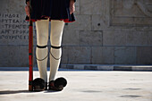 Legs of Greek presidential guardsman with rifle, Athens, Attica, Greece