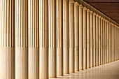 A long line of Doric pillars recedes into the distance in the Stoa of Attalos marble colonnade, Athens, Attica, Greece