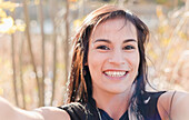 A young aboriginal female model takes a playful fun selfie outdoors in a close up headshot, Vancouver, British Columbia, Canada