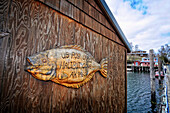 A wooden sign in the shape of a halibut announces the U.S. Post Office in Halibut Cove, Southcentral Alaska