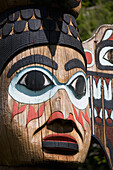 Detail of a figure carved into a Totem Pole, Totem Bight State Historical Park, Ketchikan, Southeast Alaska, USA, Spring
