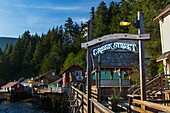The Creek Street sign and boardwalk, downtown Ketchikan, Southeast Alaska, USA, Spring